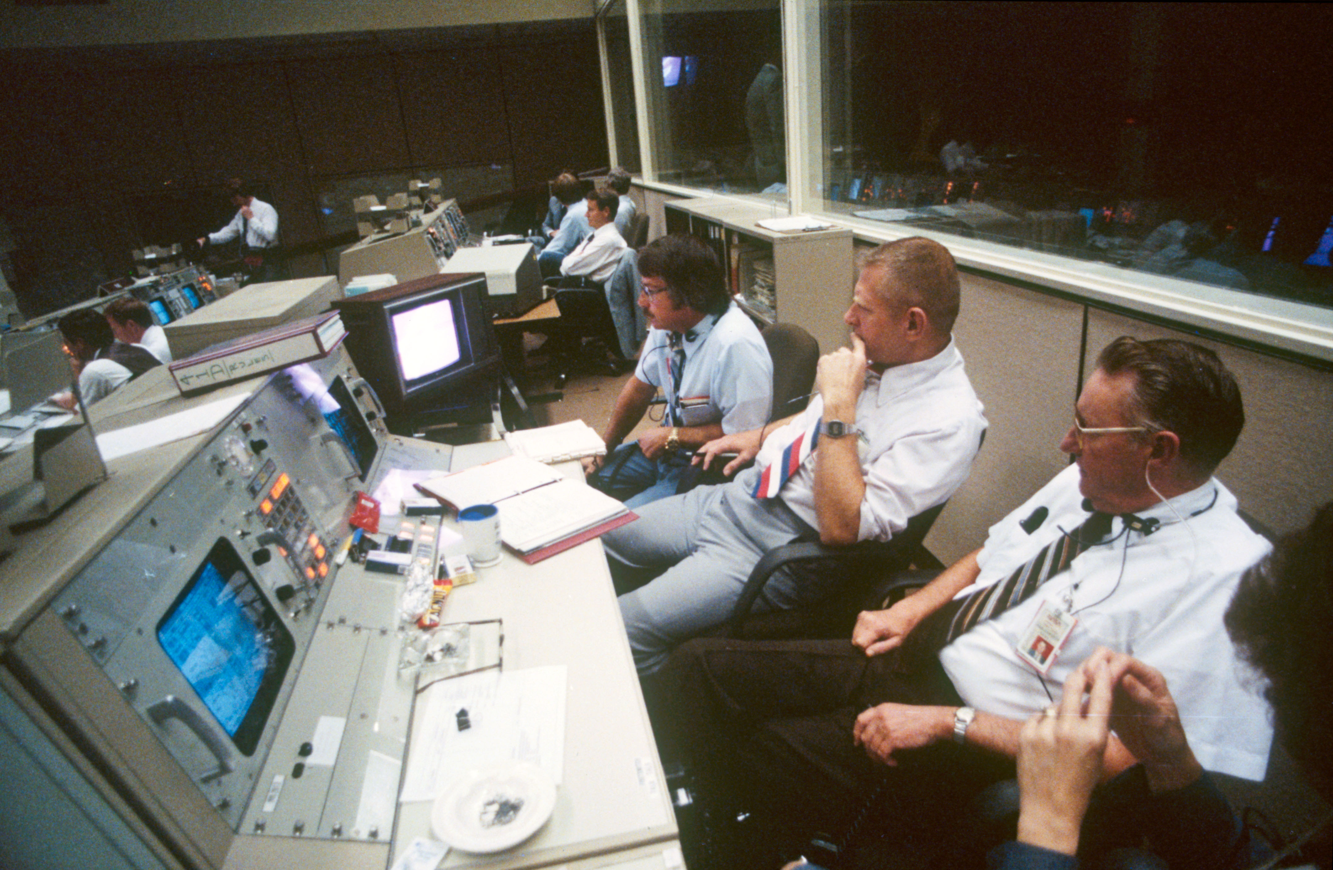 view of activity in the mission control center during sts 41 d