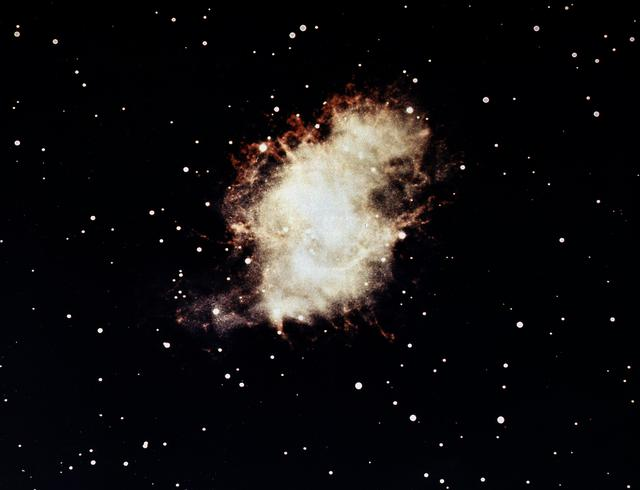 This image is of the Crab Nebula in visible light photographed by the Hale Observatory optical telescope in 1959. The faint object at the center had been identified as a pulsar and is thought to be the remains of the original star. It had been observed as a pulsar in visible light, radio wave, x-rays, and gamma-rays.
