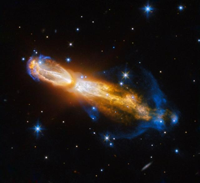 """The Calabash Nebula, pictured here — which has the technical name OH 231.8+04.2 — is a spectacular example of the death of a low-mass star like the sun. This image taken by the NASA/ESA Hubble Space Telescope shows the star going through a rapid transformation from a red giant to a planetary nebula, during which it blows its outer layers of gas and dust out into the surrounding space. The recently ejected material is spat out in opposite directions with immense speed — the gas shown in yellow is moving close to one million kilometers per hour (621,371 miles per hour).  Astronomers rarely capture a star in this phase of its evolution because it occurs within the blink of an eye — in astronomical terms. Over the next thousand years the nebula is expected to evolve into a fully-fledged planetary nebula.  The nebula is also known as the Rotten Egg Nebula because it contains a lot of sulphur, an element that, when combined with other elements, smells like a rotten egg — but luckily, it resides over 5,000 light-years away in the constellation of Puppis.  Credit: ESA/Hubble &amp; NASA, Acknowledgement: Judy Schmidt   <b><a href=""""http://www.nasa.gov/audience/formedia/features/MP_Photo_Guidelines.html"""" rel=""""nofollow"""">NASA image use policy.</a></b>  <b><a href=""""http://www.nasa.gov/centers/goddard/home/index.html"""" rel=""""nofollow"""">NASA Goddard Space Flight Center</a></b> enables NASA's mission through four scientific endeavors: Earth Science, Heliophysics, Solar System Exploration, and Astrophysics. Goddard plays a leading role in NASA's accomplishments by contributing compelling scientific knowledge to advance the Agency's mission.  <b>Follow us on <a href=""""http://twitter.com/NASAGoddardPix"""" rel=""""nofollow"""">Twitter</a></b>  <b>Like us on <a href=""""http://www.facebook.com/pages/Greenbelt-MD/NASA-Goddard/395013845897?ref=tsd"""" rel=""""nofollow"""">Facebook</a></b>  <b>Find us on <a href=""""http://instagrid.me/nasagoddard/?vm=grid"""" rel=""""nofollow"""">Instagram</a></b>"""