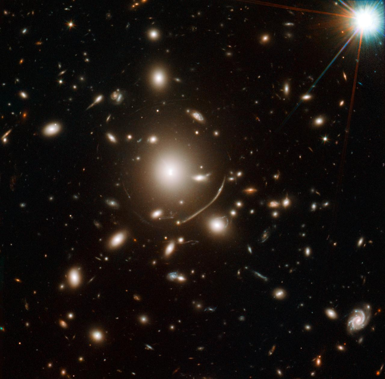 "NASA image release April 12, 2011  Astronomers have uncovered one of the youngest galaxies in the distant universe, with stars that formed 13.5 billion years ago, a mere 200 million years after the Big Bang. The finding addresses questions about when the first galaxies arose, and how the early universe evolved.  NASA's Hubble Space Telescope was the first to spot the newfound galaxy. Detailed observations from the W.M. Keck Observatory on Mauna Kea in Hawaii revealed the observed light dates to when the universe was only 950 million years old; the universe formed about 13.7 billion years ago.  Infrared data from both Hubble and NASA's Spitzer Space Telescope revealed the galaxy's stars are quite mature, having formed when the universe was just a toddler at 200 million years old.  The galaxy's image is being magnified by the gravity of a massive cluster of galaxies (Abell 383) parked in front of it, making it appear 11 times brighter. This phenomenon is called gravitational lensing.  Hubble imaged the lensing galaxy Abell 383 with the Wide Field Camera 3 and the Advanced Camera for Surveys in November 2010 through March 2011.  Credit: NASA, ESA, J. Richard (Center for Astronomical Research/Observatory of Lyon, France), and J.-P. Kneib (Astrophysical Laboratory of Marseille, France)  <b><a href=""http://www.nasa.gov/centers/goddard/home/index.html"" rel=""nofollow"">NASA Goddard Space Flight Center</a></b> enables NASA's mission through four scientific endeavors: Earth Science, Heliophysics, Solar System Exploration, and Astrophysics. Goddard plays a leading role in NASA's accomplishments by contributing compelling scientific knowledge to advance the Agency's mission.  <b>Follow us on <a href=""http://twitter.com/NASA_GoddardPix"" rel=""nofollow"">Twitter</a></b>  <b>Join us on <a href=""http://www.facebook.com/pages/Greenbelt-MD/NASA-Goddard/395013845897?ref=tsd"" rel=""nofollow"">Facebook</a></b>"
