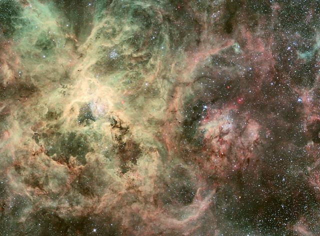 """NASA image release May 11, 2010  Hubble Catches Heavyweight Runaway Star Speeding from 30 Doradus  Image: ESO 2.2-m WFI Image of the Tarantula Nebula  A blue-hot star, 90 times more massive than our Sun, is hurtling across space fast enough to make a round trip from Earth to the Moon in merely two hours. Though the speed is not a record-breaker, it is unique to find a homeless star that has traveled so far from its nest. The only way the star could have been ejected from the star cluster where it was born is through a tussle with a rogue star that entered the binary system where the star lived, which ejected the star through a dynamical game of stellar pinball. This is strong circumstantial evidence for stars as massive as 150 times our Sun's mass living in the cluster. Only a very massive star would have the gravitational energy to eject something weighing 90 solar masses. The runaway star is on the outskirts of the 30 Doradus nebula, a raucous stellar breeding ground in the nearby Large Magellanic Cloud. The finding bolsters evidence that the most massive stars in the local universe reside in 30 Doradus, making it a unique laboratory for studying heavyweight stars. 30 Doradus, also called the Tarantula Nebula, is roughly 170,000 light-years from Earth.  To learn more about this image go to: <a href=""""http://www.nasa.gov/mission_pages/hubble/science/runaway-star.html"""" rel=""""nofollow"""">www.nasa.gov/mission_pages/hubble/science/runaway-star.html</a>  Credit: NASA/ESO, J. Alves (Calar Alto, Spain), and B. Vandame and Y. Beletski (ESO)  <b><a href=""""http://www.nasa.gov/centers/goddard/home/index.html"""" rel=""""nofollow"""">NASA Goddard Space Flight Center</a></b>  is home to the nation's largest organization of combined scientists, engineers and technologists that build spacecraft, instruments and new technology to study the Earth, the sun, our solar system, and the universe."""
