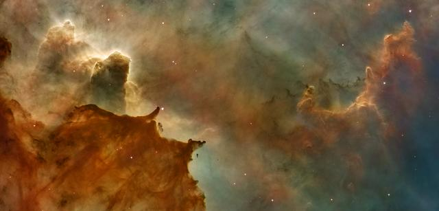 """Carina Nebula Details: Great Clouds  Credit for Hubble Image: NASA, ESA, N. Smith (University of California, Berkeley), and The Hubble Heritage Team (STScI/AURA)  Credit for CTIO Image: N. Smith (University of California, Berkeley) and NOAO/AURA/NSF  The Hubble Space Telescope is a project of international cooperation between NASA and the European Space Agency. NASA's Goddard Space Flight Center manages the telescope. The Space Telescope Science Institute conducts Hubble science operations.  Goddard is responsible for HST project management, including mission and science operations, servicing missions, and all associated development activities.  To learn more about the Hubble Space Telescope go here: <a href=""""http://www.nasa.gov/mission_pages/hubble/main/index.html"""" rel=""""nofollow"""">www.nasa.gov/mission_pages/hubble/main/index.html</a>   <b><a href=""""http://www.nasa.gov/centers/goddard/home/index.html"""" rel=""""nofollow"""">NASA Goddard Space Flight Center</a></b>  is home to the nation's largest organization of combined scientists, engineers and technologists that build spacecraft, instruments and new technology to study the Earth, the sun, our solar system, and the universe.  <b>Follow us on <a href=""""http://twitter.com/NASA_GoddardPix"""" rel=""""nofollow"""">Twitter</a></b>  <b>Join us on <a href=""""http://www.facebook.com/pages/Greenbelt-MD/NASA-Goddard/395013845897?ref=tsd"""" rel=""""nofollow"""">Facebook</a><b> </b></b>"""