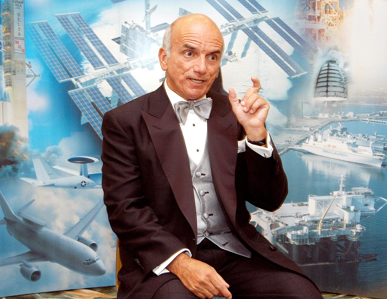 Dennis Tito, the first private citizen to visit the International Space Station, shares his experiences at the 40th Space CongressNASA photo KSC-03pd1489 (30 April 2003) KSC-03pd1489~medium.jpg
