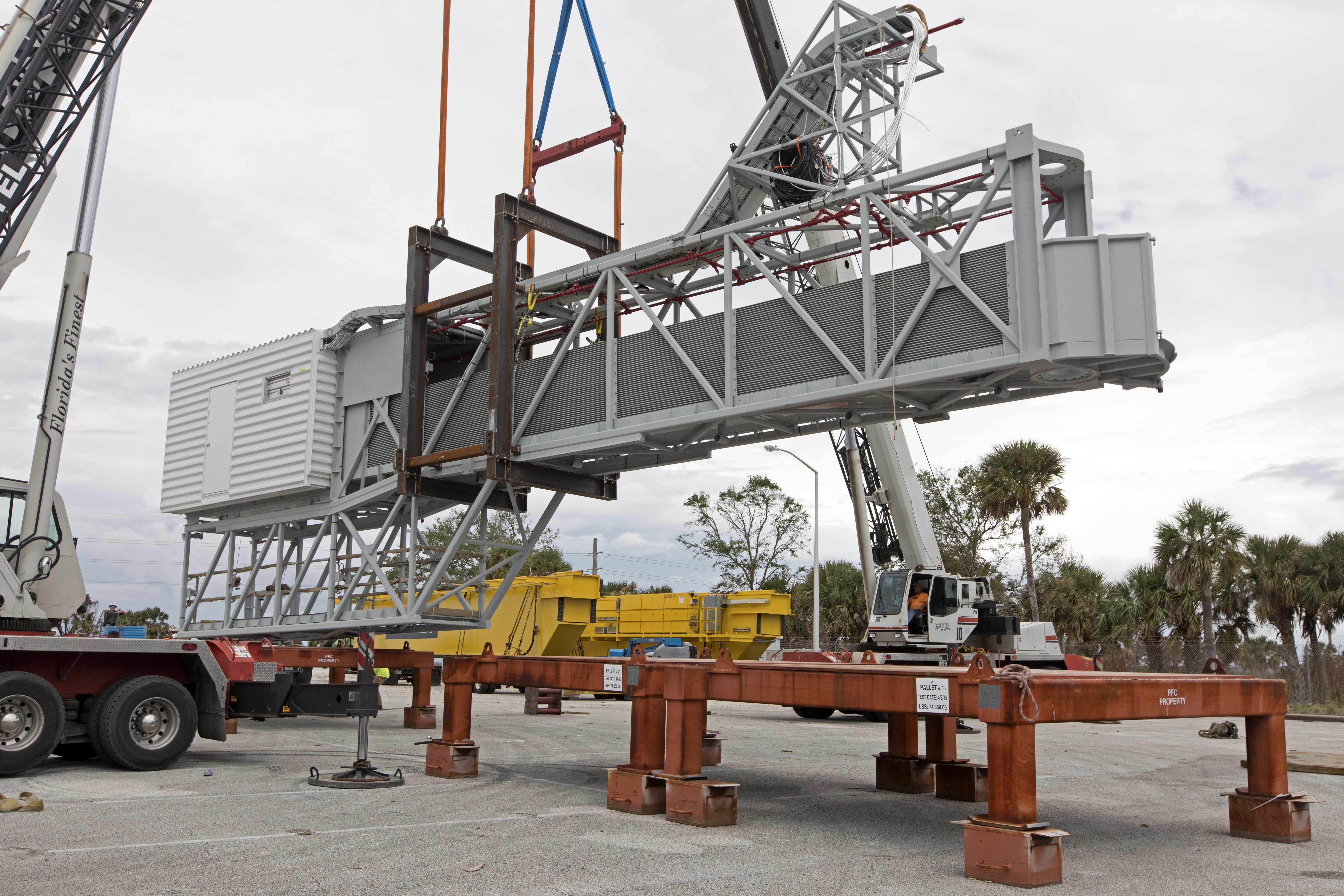 mobile launcher crew access arm transport from cocoa fl to ksc