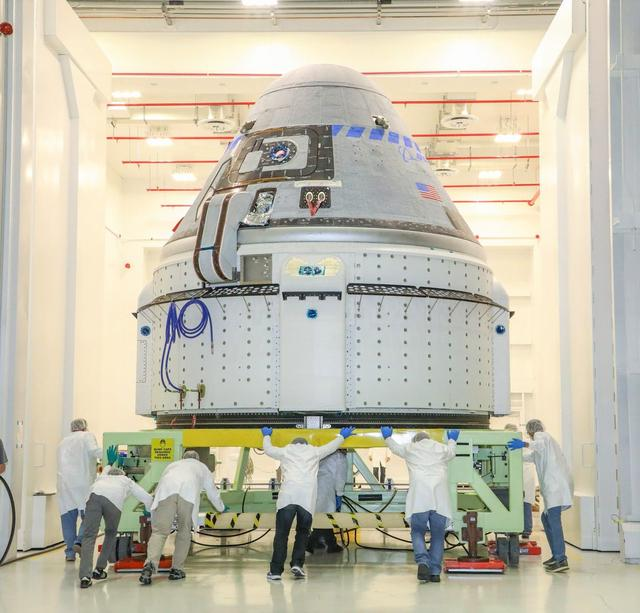 The CST-100 Starliner spacecraft to be flown on Boeing's Orbital Flight Test (OFT) is viewed Nov. 2, 2019, while undergoing launch preparations inside the Commercial Crew and Cargo Processing Facility at Kennedy Space Center in Florida. During the OFT mission, the uncrewed Starliner spacecraft will fly to the International Space Station for NASA's Commercial Crew Program.