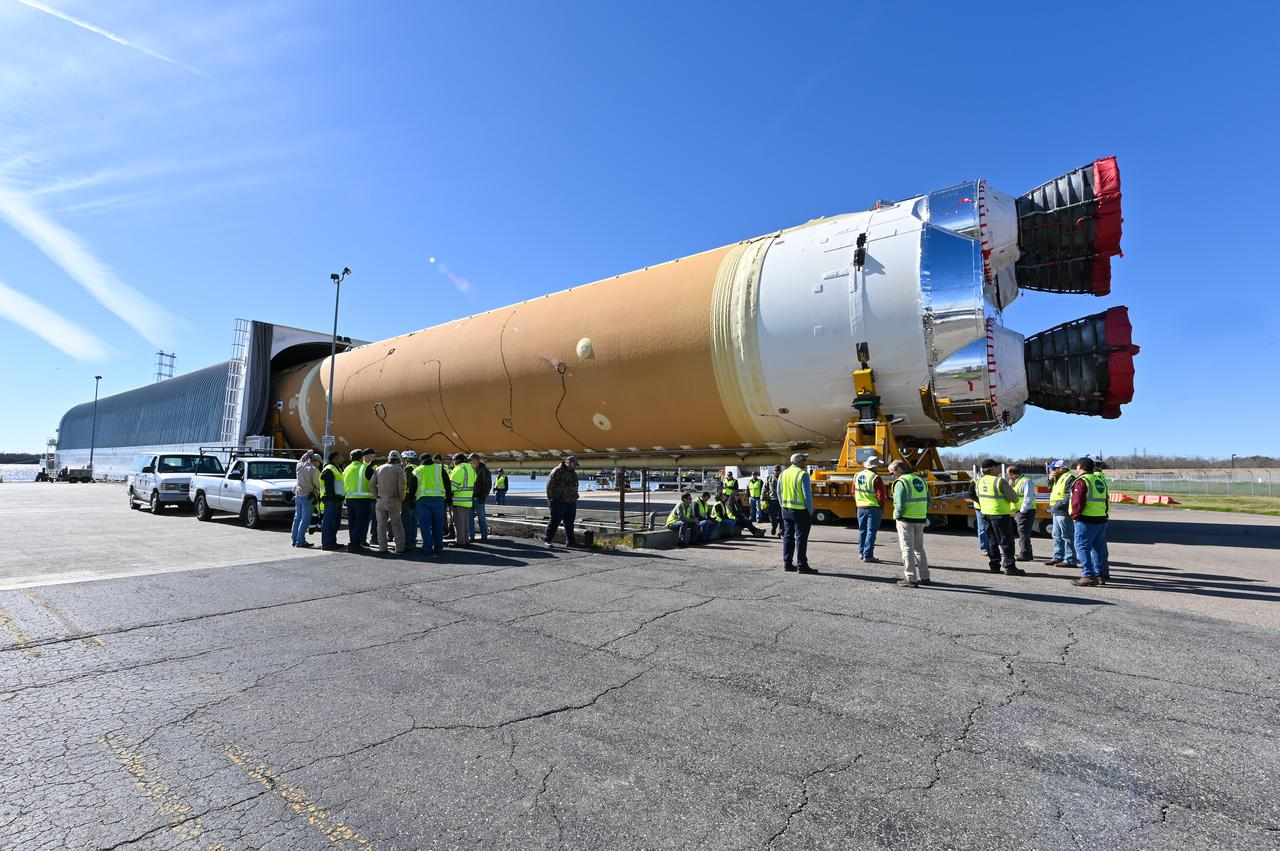 These images show how teams rolled out, or moved, the completed core stage for NASA's Space Launch System rocket from NASA's Michoud Assembly Facility in New Orleans. Crews moved the flight hardware for the first Artemis mission to NASA's Pegasus barge on Jan. 8 in preparation for the core stage Green Run test series at NASA's Stennis Space Center near Bay St. Louis, Mississippi. Pegasus, which was modified to ferry SLS rocket hardware, will transport the core stage from Michoud to Stennis for the comprehensive core stage Green Run test series. Once at Stennis, the Artemis rocket stage will be loaded into the B-2 Test Stand for the core stage Green Run test series. The comprehensive test campaign will progressively bring the entire core stage, including its avionics and engines, to life for the first time to verify the stage is fit for flight ahead of the launch of Artemis I.