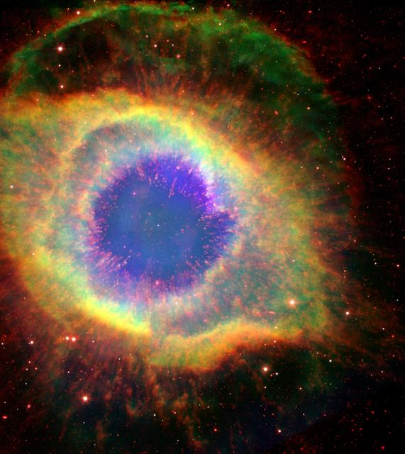 Six hundred and fifty light-years away in the constellation Aquarius, a dead star about the size of Earth, is refusing to fade away peacefully. NASA Hubble and Spitzer Space Telescopes have captured the complex structure of the Helix nebula.