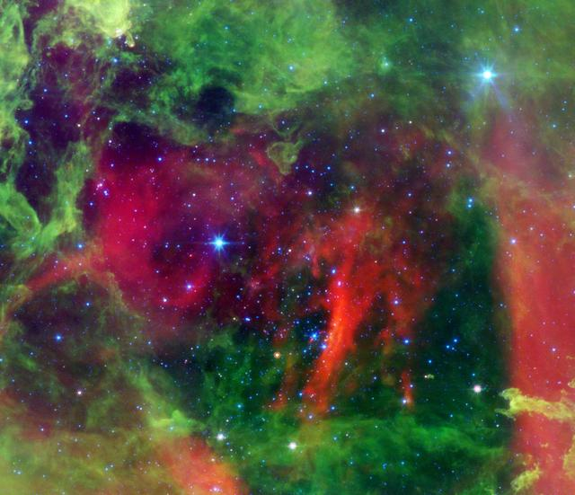This infrared image from NASA Spitzer Space Telescope shows the Rosette nebula, a pretty star-forming region more than 5,000 light-years away in the constellation Monoceros.