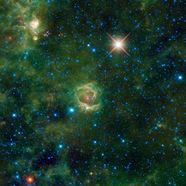Nebulae are enormous clouds of dust and gas occupying the space between the stars. Simply called LBN 114.55+00.22, is seen here in an image from NASA Wide-field Infrared Survey Explorer.