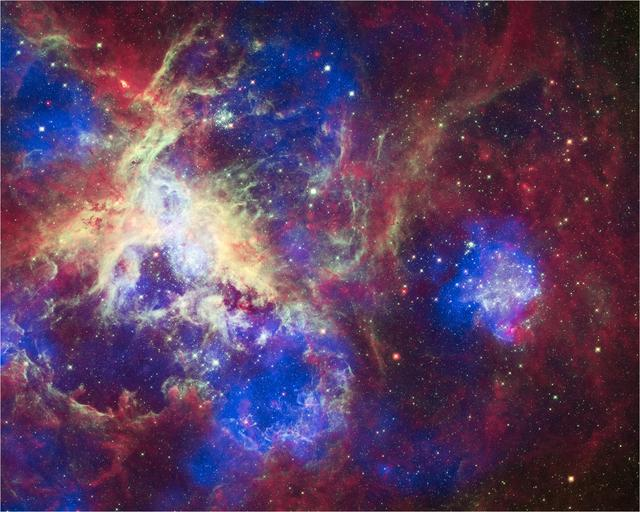 This composite of 30 Doradus, the Tarantula Nebula, contains data from Chandra blue, Hubble green, and Spitzer red. Located in the Large Magellanic Cloud, the Tarantula Nebula is one of the largest star-forming regions close to the Milky Way.