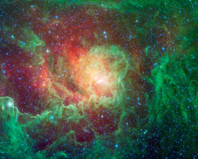 Swirling dust clouds and bright newborn stars dominate the view in this image of the Lagoon nebula from NASA Spitzer Space Telescope. The nebula lies in the general direction of the center of our galaxy in the constellation Sagittarius.
