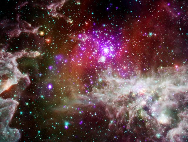 This composite image of the star cluster NGC 28 contains X-ray data from Chandra, in purple, with infrared observations from Spitzer, in red, green, blue. NGC 281 is known informally as the Pacman Nebula because of its appearance in optical images.
