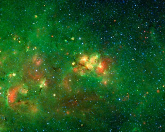 This nebula, which is in the constellation of Scutum, has no common name since it is hidden behind dust clouds. It takes an infrared telescope like NASA Spitzer to see through this dark veil and reveal this spectacular hidden nebula.