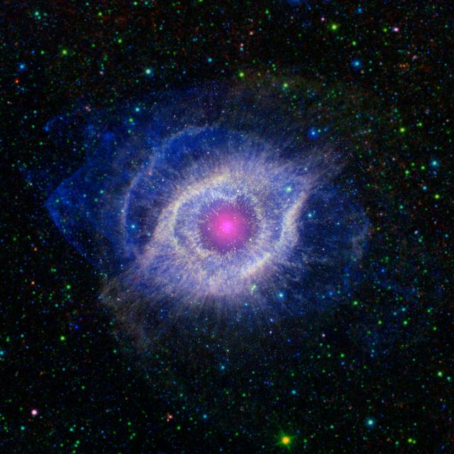 This image from NASA Spitzer and GALEX shows the Helix nebula, a dying star throwing a cosmic tantrum. In death, the star dusty outer layers are unraveling into space, glowing from the intense UV radiation being pumped out by the hot stellar core.