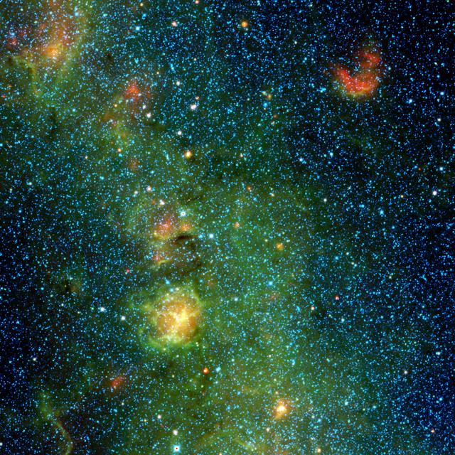 Radiation and winds from massive stars have blown a cavity into the surrounding dust and gas, creating the Trifid nebula, as seen here in infrared light by NASA Wide-field Infrared Survey Explorer, or WISE.