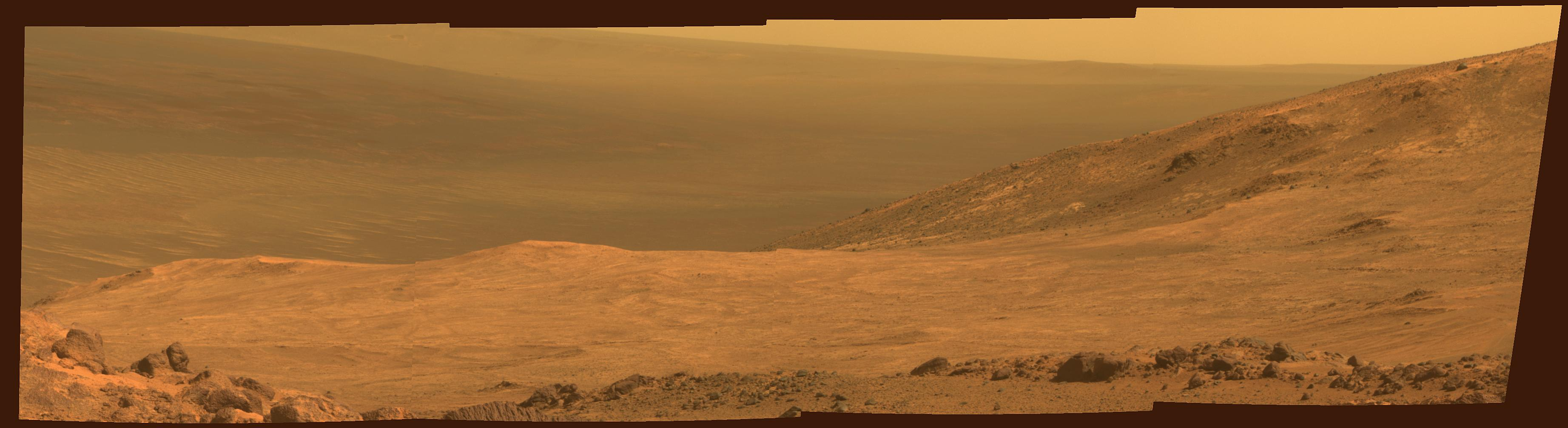This view from NASA Mars Exploration Rover Opportunity shows part of Marathon Valley, a destination on the western rim of Endeavour Crater, as seen from an overlook north of the valley.