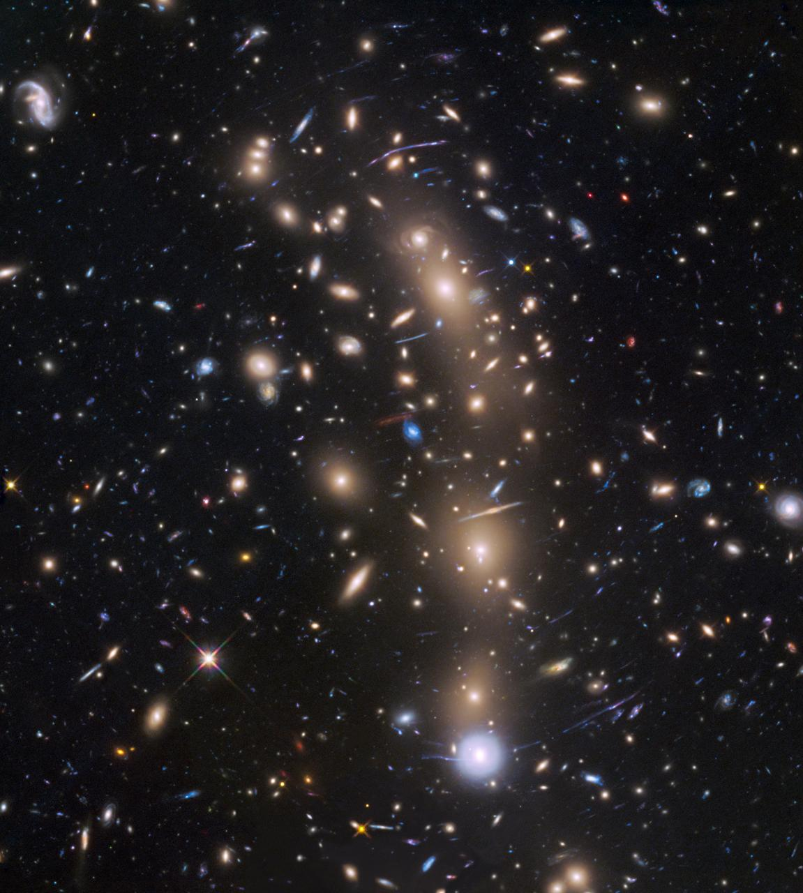 This is view from ESA Hubble Space Telescope of a very massive cluster of galaxies, MACS J0416.1-2403, located roughly 4 billion light-years away and weighing as much as a million billion suns.