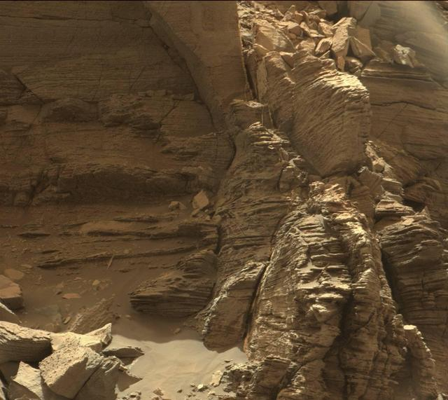 This view from the Mast Camera Mastcam in NASA's Curiosity Mars rover shows an outcrop with finely layered rocks within the Murray Buttes region on lower Mount Sharp.