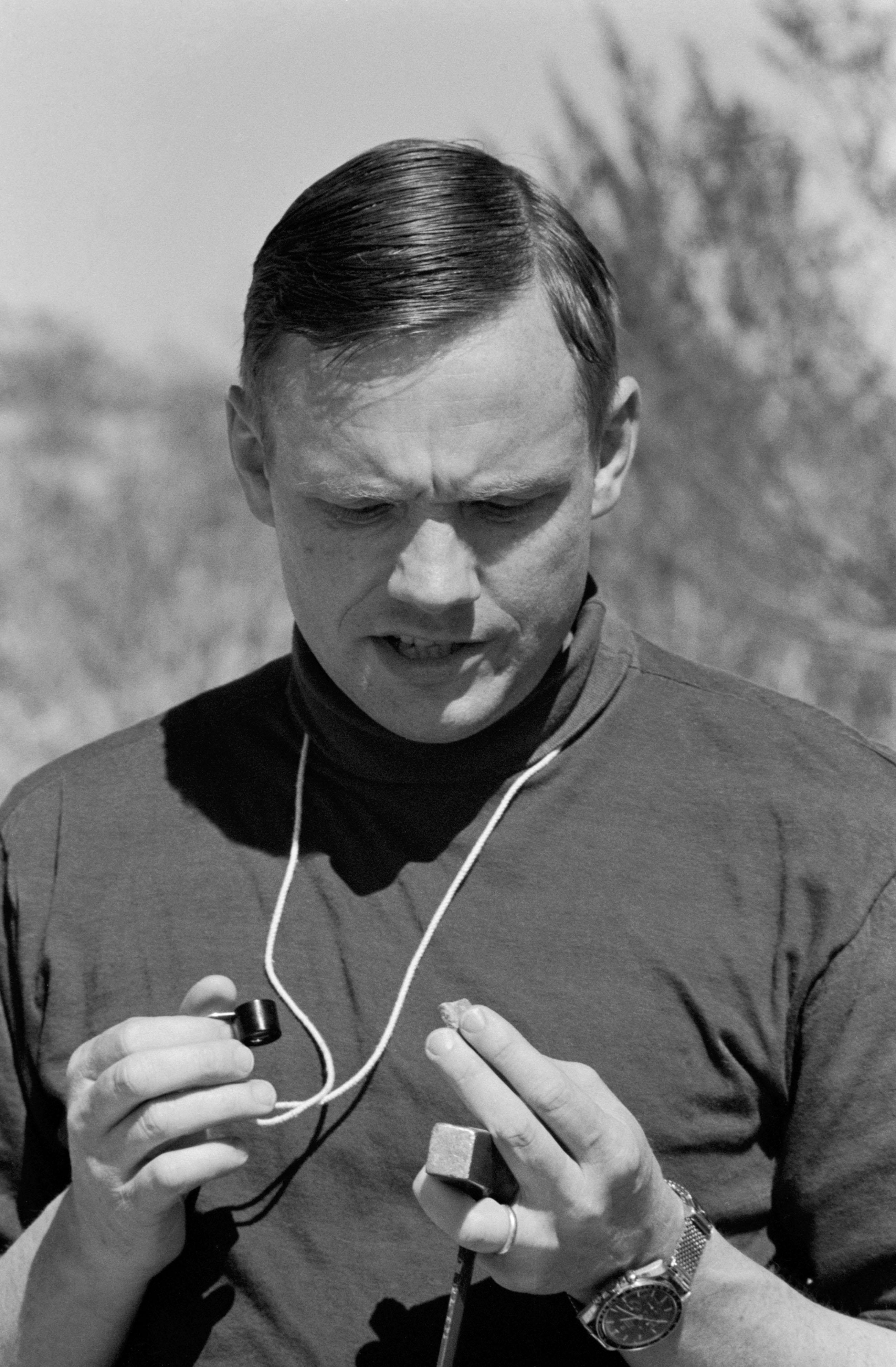 Astronaut Neil Armstrong Rock Sample Study Geological Field