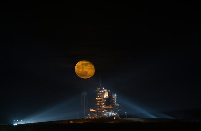 The Moon is seen rising behind the Space Shuttle Endeavour (STS-126) on pad 39a Friday, November 14, 2008, at the Kennedy Space Center in Cape Canaveral, Fla. The Shuttle lifted off from launch pad 39A at 7:55 p.m. EST. Photo Credit: (NASA/Bill Ingalls)