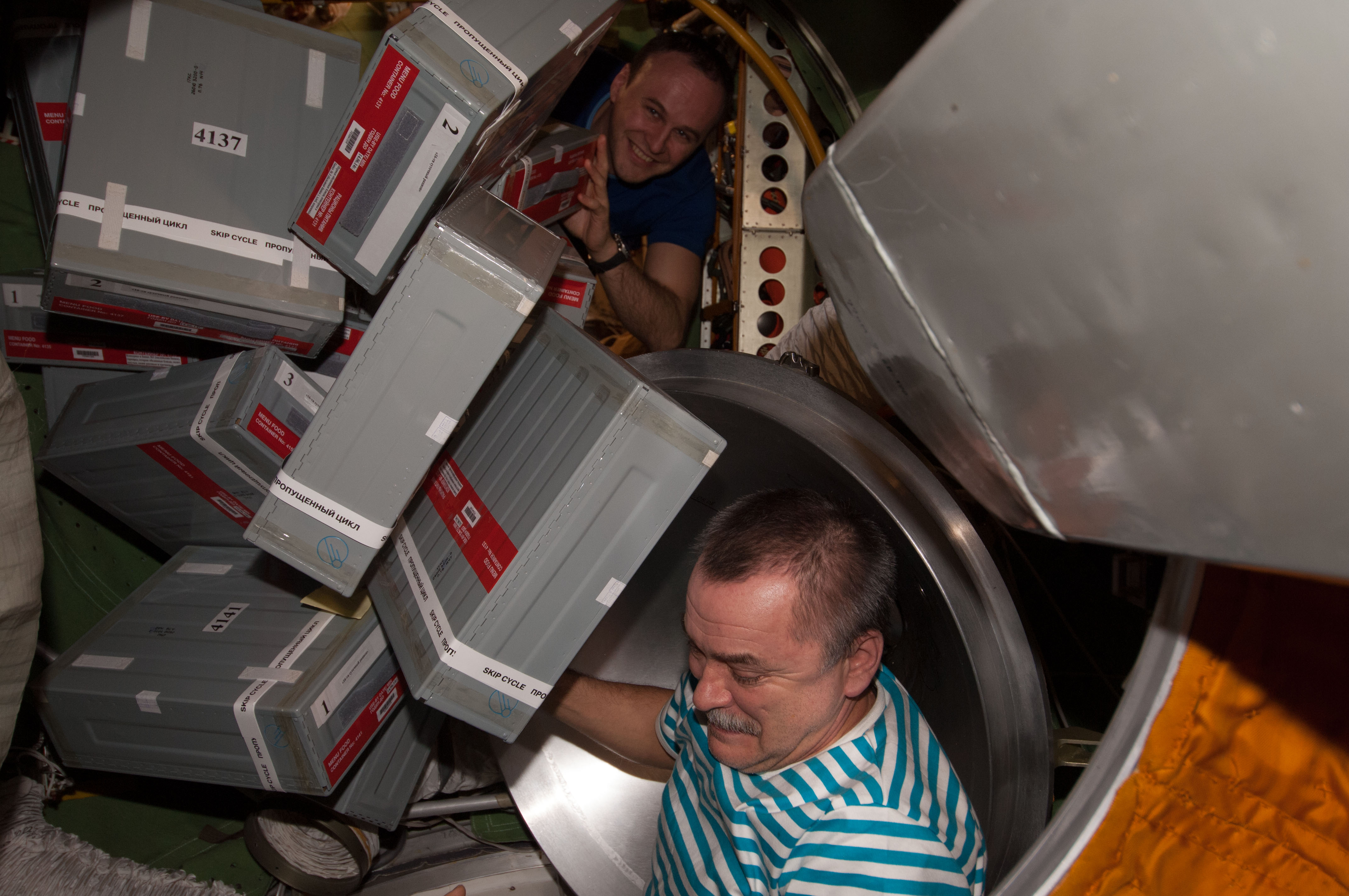 Tyurin And Ryazanskiy Unpacks Storage Containers Nasa Image Moving The Wing