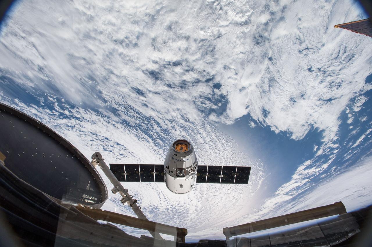 iss055e009956 (April 4, 2018) --- The SpaceX Dragon resupply ship nears its capture point about 10 meters away from the International Space Station. Japanese astronaut Norishige Kanai commanded the Canadian Space Agency's Canadarm2 robotic arm to grapple Dragon at 6:40 a.m. EDT over the southern part of the Democratic Republic of the Congo in Africa. NASA astronaut Scott Tingle backed up Kanai while monitoring the cargo ship's approach and rendezvous.