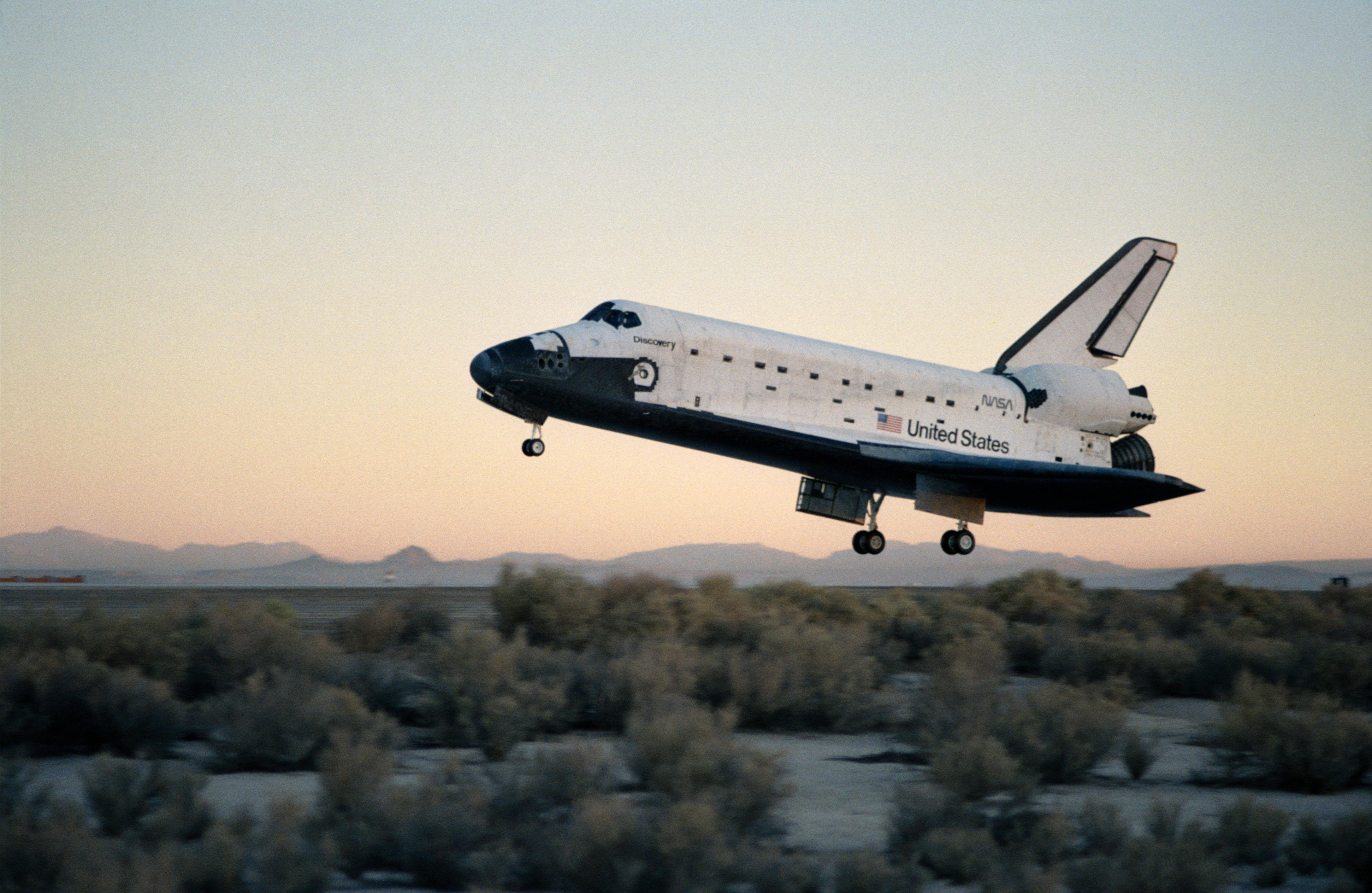 Discovery, drifting toward a landing at Edwards Air Force Base at