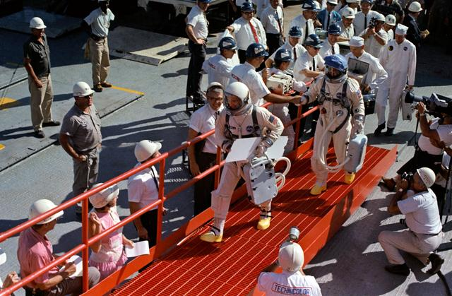 Gemini 12 prime crew walk up ramp at Pad 19 during prelaunch countdown, NASA photo Source: images.nasa.gov s66-59966~small.jpg