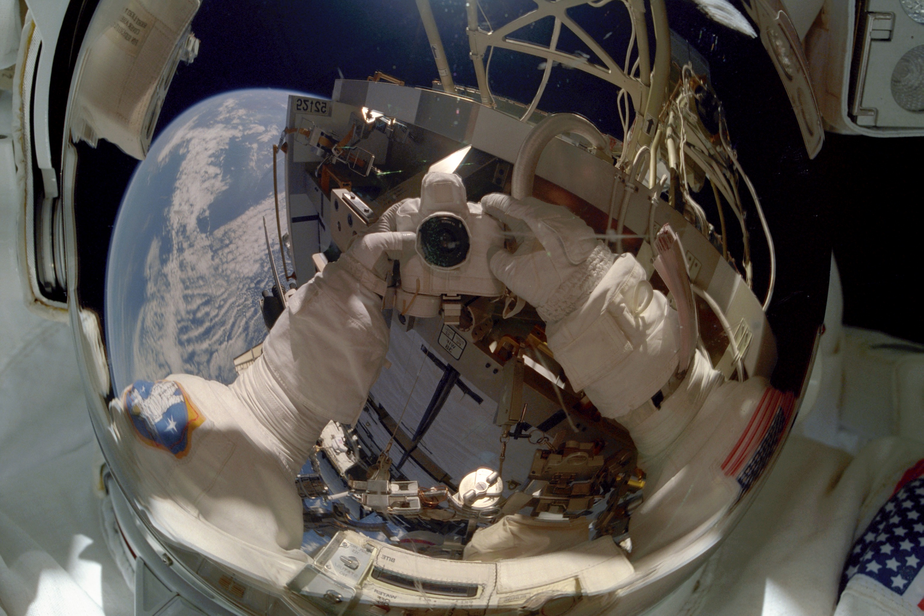 MS Tanner Takes A Picture Of Himself In His Visor During An EVA STS 97